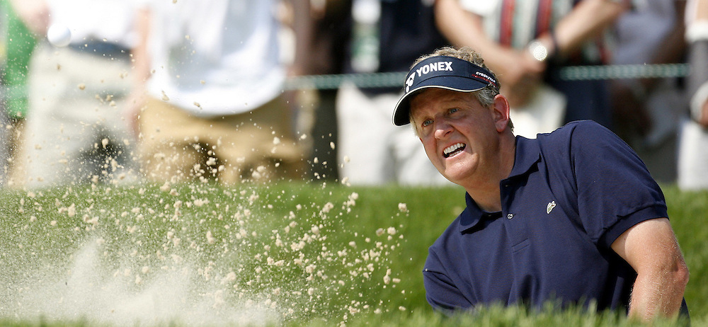 Colin Montgomerie of Scotland hits out of the bunker on the fifth hole during the final day of the US Open Golf Championship at Winged Foot Golf Club in Mamaroneck, New York Sunday, 18 June 2006. .