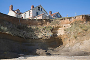 Cliff top buildings at risk of coastal erosion, Happisburgh, Norfolk, England