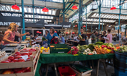 Vegetable stall at at indoor market , Markethalle Neun, Kreuzberg, Berlin, Germany.