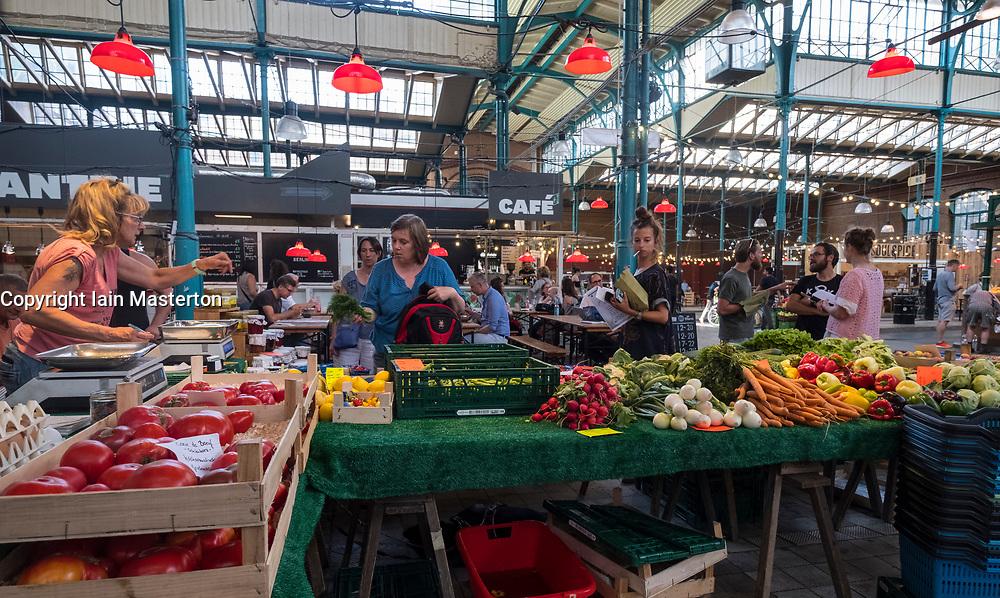 Vegetable stall at at indoor market , Markethalle Neun, Kreuzberg, Berlin, Germany.