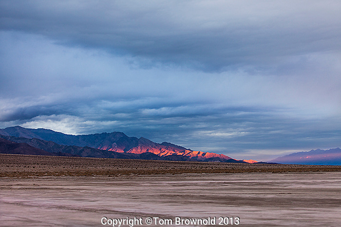 A winter storm moving effecting the sunrise over the Panamint Mountains. Image made from the Middle Basin of Death Valley and Salt Creek.