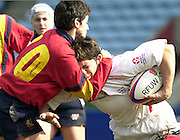 Twickenham. England, Women's International Rugby England v Spain, at the Twickenham Stoop. on 09/03/2003. Vannessa Huxford tackled. [Mandatory Credit: Peter Spurrier/ Intersport Images]