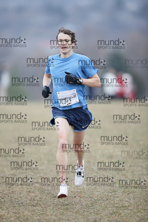 Simon Whitfield of Prairie Inn Harriers Racing Team runs in the Senior Men's race at the 2009 AGSI Cross Country Championships in Guelph, Ontario, November 28, 2009..GEOFF ROBINS/ Mundo Sport Images
