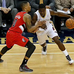 Dec 30, 2013; New Orleans, LA, USA; New Orleans Pelicans point guard Jrue Holiday (11) drives past Portland Trail Blazers point guard Damian Lillard (0) during the first half of a game at the New Orleans Arena. Mandatory Credit: Derick E. Hingle-USA TODAY Sports