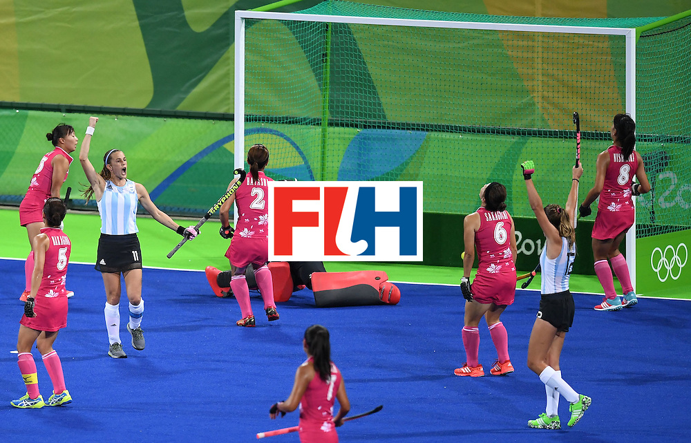 Argentina's Carla Rebecchi (2R) celebrates scoring a goal during the women's field hockey Argentina vs Japan match of the Rio 2016 Olympics Games at the Olympic Hockey Centre in Rio de Janeiro on August, 8 2016. / AFP / MANAN VATSYAYANA        (Photo credit should read MANAN VATSYAYANA/AFP/Getty Images)