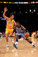 06 November 2009: Guard OJ Mayo of the Memphis Grizzles drives to the basket while being guarded by Sasha Vujacic of the Los Angeles Lakers during the first half of the Lakers 114-98 victory over the Grizzles at the STAPLES Center in Los Angeles, CA.
