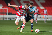 Doncaster Rovers Forward John Marquis (9) battles with Blackpool Midfielder Ian Black (37) during the EFL Sky Bet League 2 match between Doncaster Rovers and Blackpool at the Keepmoat Stadium, Doncaster, England on 17 April 2017. Photo by Craig Zadoroznyj.