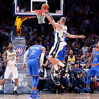 09 November 2017: Denver Nuggets center Mason Plumlee (24) goes for the layup against Oklahoma City Thunder center Steven Adams (12) during the Denver Nuggets 102-94 victory over the Oklahoma City Thunder, at the Pepsi Center, Denver, Colorado, USA.