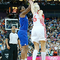 09 August 2012: France Endene Miyem takes a jumpshot over Russia Natalya Vodopyanova during 81-64 Team France victory over Team Russia, during the women's basketball semi-finals, at the 02 Arena, in London, Great Britain.