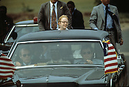 Amy Carter sticks her head out of the presidential limo during a parade in Monorvia, Liberia...Photograph by Dennis Brack bb 27