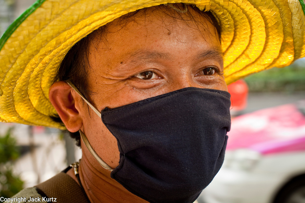 Mar 31, 2010 - BANGKOK, THAILAND: A man on Sukhumvit Road in Bangkok wears a breathing mask because of the pollution at street level. Bangkok residents in 2007 produced as much carbon dioxide as New Yorkers and surpassed Londoners' emissions by 1.2 tons per capita, according to a United Nations sponsored report. Residents in Bangkok and New York each emitted 7.1 tons of the greenhouse gas in 2007 while London residents emitted 5.9 tons, according to a report compiled by the Bangkok government and the Green Leaf Foundation, a Bangkok-based environmental group, with support from the United Nations. Bangkok's transportation, electricity generation and solid wastewater treatment produced 90 per cent of the Thai capital's carbon dioxide with the transport sector alone accounting for almost 38 per cent of the annual total, the report said.   PHOTO BY JACK KURTZ