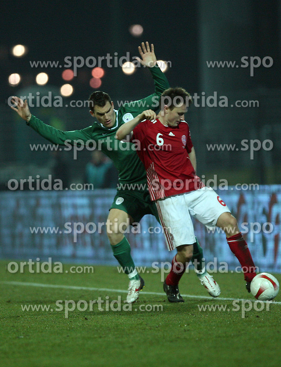 Dejan Rusic (9) of Slovenia and William Kvist (6) of Denmark during the UEFA Friendly match between national teams of Slovenia and Denmark at the Stadium on February 6, 2008 in Nova Gorica, Slovenia. Slovenia lost 2:1. (Photo by Vid Ponikvar / Sportal Images).