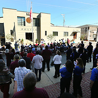 Starkville residents, city officials and members of the police department gather on Lumpkin Street for the grand opening ceremony of the renovated Strakville Police Department Friday morning in Starkville.