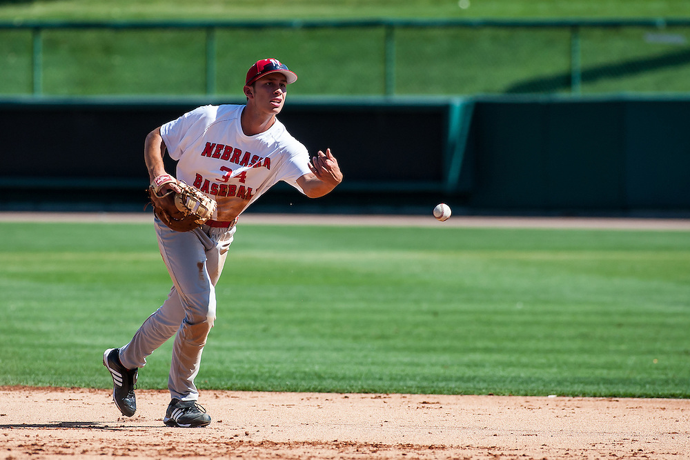 September 04, 2012: Austin Christensen flips the ball to first during fall practice. Photo by John S. Peterson.