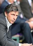 A dejected Claude Puel the Lyon manager reflects as his side go 2-0 down. Toulouse v Lyon (2-0), Ligue 1, Stade Municipal, Toulouse, France, 1st May 2011.