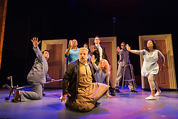 """© Licensed to London News Pictures. 08/10/2014. London, England. At centre: Kev Orkian as Mahmoud. The Musical """"The Infidel"""", based on the same named film by David Baddiel,  premieres at the Theatre Royal Stratford East, London. Directed by David Baddiel and Kerry Michael, book and lyrics by David Baddiel with music by Erran Baron Cohen. The Infidel is a story about Muslim man Mahmoud (Kev Orkian) who discovered that he is not only adopted but also Jewish. Photo credit: Bettina Strenske/LNP"""