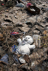 26th Sept, 2005.  Cameron, Louisiana. Hurricane Rita aftermath. <br /> A child's teddy bear lies stuck in the mud amidst the destroyed remains of downtown Cameron, Louisiana two days after the storm ravaged the small town.<br /> Photo; ©Charlie Varley/varleypix.com