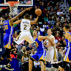 Oct 28, 2016; New Orleans, LA, USA;  New Orleans Pelicans guard Tim Frazier (2) shoots over Golden State Warriors forward Kevin Durant (35) during the first quarter of a game at the Smoothie King Center. Mandatory Credit: Derick E. Hingle-USA TODAY Sports