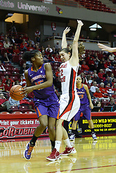 01 January 2012:  Briyana Blair looks to pass around defender Alison Seberger during an NCAA women's basketball game between the Evansville Purple Aces and the Illinois Sate Redbirds at Redbird Arena in Normal IL