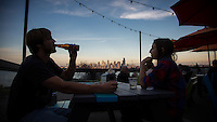 Seattle, Washington- October 2, 2014: Patrons take in the amazing view from  Marination Ma Kai, a Hawaiian-Korean fusion restaurant in West Seattle. The restaurant is a short water-taxi ride away from downtown Seattle. CREDIT: Chris Carmichael for the New York Times