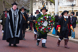 London, January 25th 2015. Every year on the last Sunday in January history enthusiatsts re-enact the King's Army parade along the route walked by King Charles I on the morning of 30th January 1649, from St James Palace to the Banqueting House in Whitehall, where  he was executed. To avoid closing Whitehall to traffic, the parade now ends on Horse Guards Parade. PICTURED: A wreath remembering King Charles I, to be laid at Banqueting House, is carried in the Parade