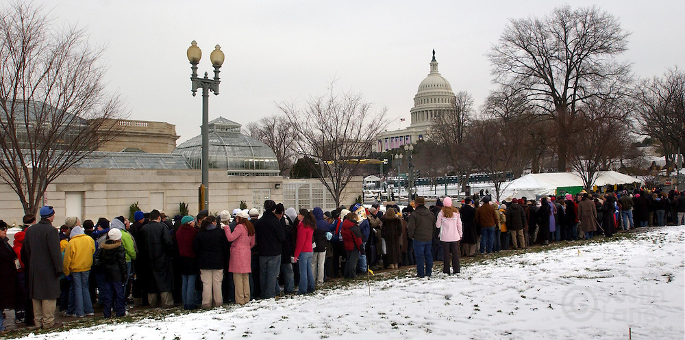 A line of people wait to go through security in order to attend United States President George W. Bush's inauguration in Washington Thursday 20 January 2005. This will be the 55th Presidential Inaugurational and will mark the start of Bush's second term in office.