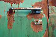 close up of door handle of an old rusty big American car