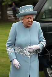 Queen Elizabeth II arrives to attend the Cartier Trophy at the Guards Polo Club, Windsor Great Park, Surrey.