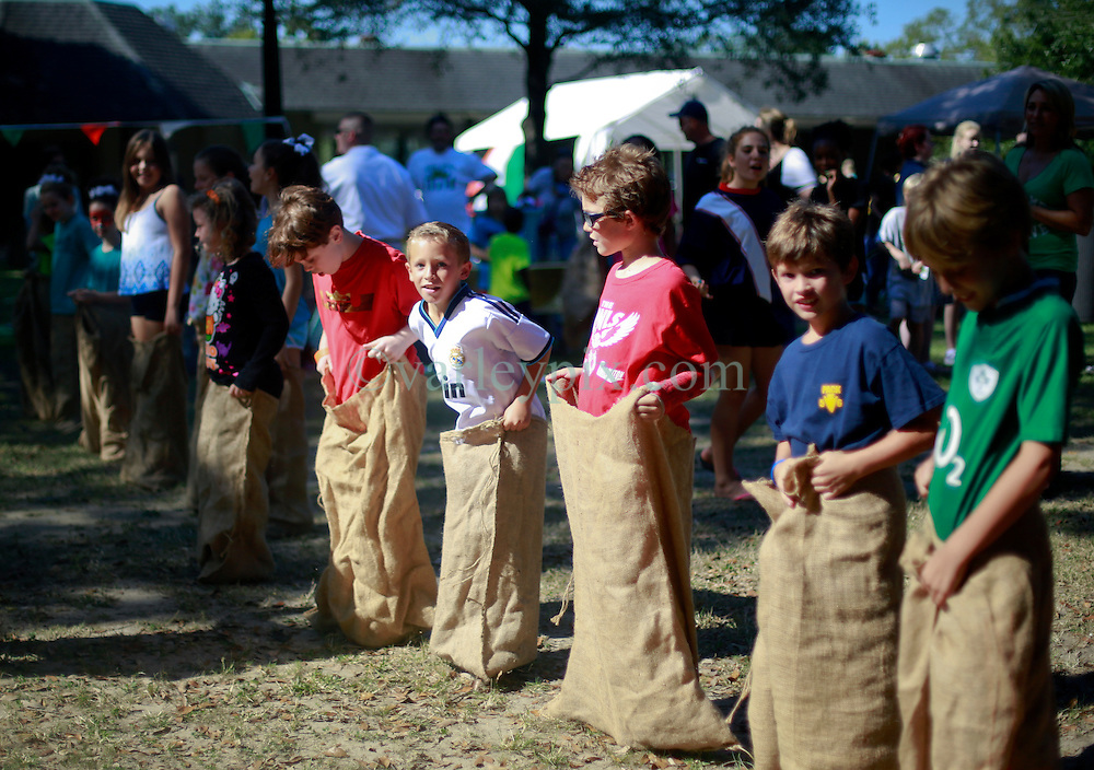 19 October 2014. New Orleans, Louisiana. <br /> Benny and friends get ready for sack racing at the New Orleans' Irish Network's third Family Day event with fun and games for kids and adults alike. With Irish dancing, egg and spoon and sack races with a good old fashioned tug of war to round things off.<br /> Photo; Charlie Varley/varleypix.com