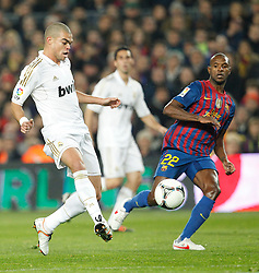 25.01.2012, Stadion Camp Nou, Barcelona, ESP, Copa del Rey, FC Barcelona vs Real Madrid, im Bild Barcelona's Eric Abidal and Real Madrid's Pepe // during the football match of spanish Copy del Rey, between FC Barcelona and Real Madrid at Camp Nou stadium, Barcelona, Spain on 2012/01/25. EXPA Pictures © 2012, PhotoCredit: EXPA/ Alterphotos/ Cesar Cebolla..***** ATTENTION - OUT OF ESP and SUI *****