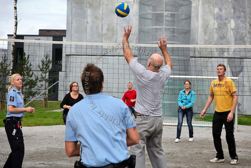 Guards (left and right) are regularly spending time with inmates in various open areas where games like soccer, volleyball and basketball are organised in mixed teams of inmates, guards and other prison staff.