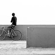 An unidentified rider looks towards the Pacific Ocean at sunset in Venice Beach California.