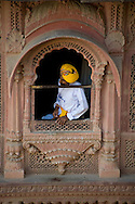 A guard wearing a colourful turban at the Mherangarth Fort in Jodhpur, Rajasthan, India