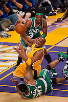17 June 2010: Guard Kobe Bryant of the Los Angeles Lakers passes the ball while falling between Paul Pierce and Rasheed Wallace of the Boston Celtics during the first half of the Lakers 83-79 championship victory over the Celtics in Game 7 of the NBA Finals at the STAPLES Center in Los Angeles, CA.