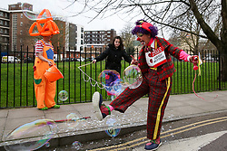 © Licensed to London News Pictures. 02/02/2020. London, UK. A clown plays with bubbles as he arrives to attend a service at All Saints Church in East London in memory of Joseph Grimaldi (1778-1837), an English actor, comedian and dancer, who is widely considered to be the 'Father' of modern clowning. Photo credit: Dinendra Haria/LNP