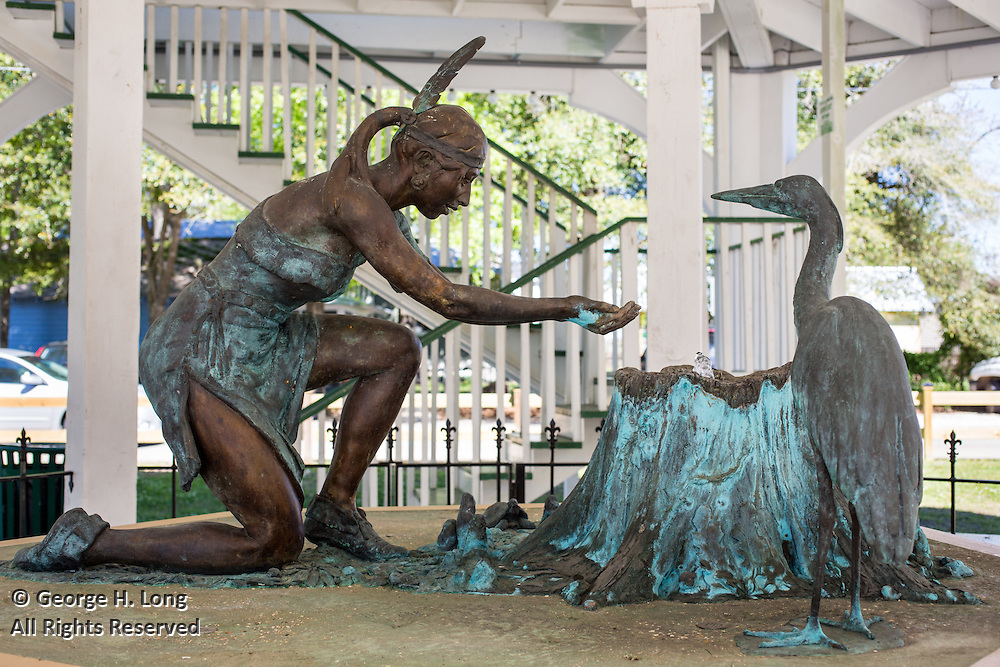 bronze statue or sculpture of the Abita Princess at the pavillion in Abita Springs Park