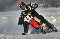 A motorcycle ice racer leans into a turn on a race track plowed from the snow on Lake Winnebago near Roosevelt park. No special event was going on, just dozen or so guys having fun going as fast as they could on specially designed motorcycles with studded tires. Sunday, January 30, 2011. The Reporter photo by Patrick Flood.