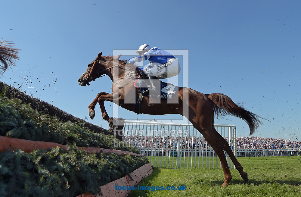 San Benedeto ridden by Nick Scholfield wins Doom Bar Maghull Novice Chase on Grand National Day of the Grand National Festival at Aintree Racecourse, Aintree<br /> Picture by Martin Lynch/Focus Images Ltd 07501333150<br /> 08/04/2017