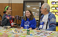Emma Dworzynski (from left), 9, of Robins, and Autumn Herndon, 13, of Marion, talk with Ed Reif of Marion during the Retreat & Refresh Stroke Camp at Camp Courageous in Monticello on Saturday, April 20, 2013. Reif is a stroke survivor.