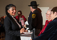 Goshen, New York - A new American citizen gets an American flag during a Naturalization ceremony at the Orange County Emergency Services Center on Nov. 17, 2016.