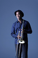 Trombone Player standing with hat smiling