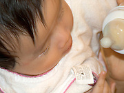 overhead view of baby with a bottle of milk