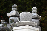 Gravestone in the shape of a coffee cup lies at Okunoin, one of the most sacred places in Japan. Presumably this person worked for UCC coffee, and wanted to be remembered this way. People from all over the country who wished to be buried close to Kobo Daishi lie there including former feudal lords, politicians and other prominent personalities. Their graves line the approaches to Okunoin for hundreds of meters throughout the forest.