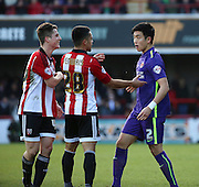 Charlton Athletic defender Yun Suk-Young (2) squaring up to Brentford attacker, Sergi Canos (47) during the Sky Bet Championship match between Brentford and Charlton Athletic at Griffin Park, London, England on 5 March 2016. Photo by Matthew Redman.