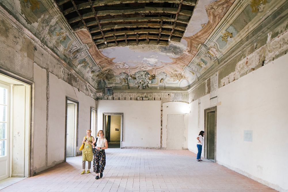 PALERMO, ITALY - 16 JUNE 2018: Visitors are seen here inside Palazzo Butera, a venue of Manifesta 12, the European nomadic art biennal, in Palermo, Italy, on June 16th 2018.<br /> <br /> Manifesta is the European Nomadic Biennial, held in a different host city every two years. It is a major international art event, attracting visitors from all over the world. Manifesta was founded in Amsterdam in the early 1990s as a European biennial of contemporary art striving to enhance artistic and cultural exchanges after the end of Cold War. In the next decade, Manifesta will focus on evolving from an art exhibition into an interdisciplinary platform for social change, introducing holistic urban research and legacy-oriented programming as the core of its model.<br /> Manifesta is still run by its original founder, Dutch historian Hedwig Fijen, and managed by a permanent team of international specialists.<br /> <br /> The City of Palermo was important for Manifesta&rsquo;s selection board for its representation of two important themes that identify contemporary Europe: migration and climate change and how these issues impact our cities.