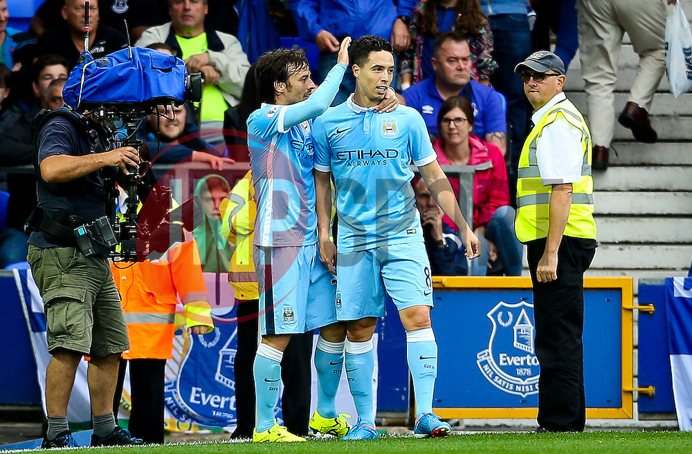 Samir Nasri of Manchester City celebrates his sides second goal with David Silva - Mandatory byline: Matt McNulty/JMP - 07966386802 - 23/08/2015 - FOOTBALL - Goodison Park -Everton,England - Everton v Manchester City - Barclays Premier League