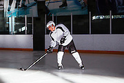 Los Angeles Chef Sang Yoon plays hockey with a friend at Toyota Sports Center in El Segundo, California December 17, 2015.<br /> <br /> CREDIT: Kendrick Brinson for The Wall Street Journal
