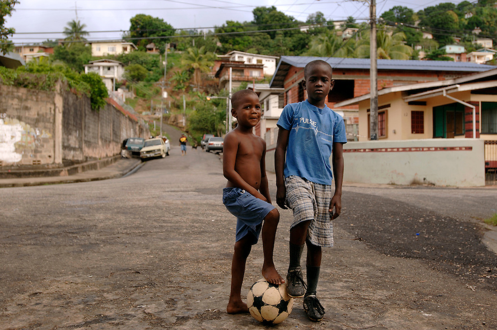 .Trinidad & Tobago, Port of Spain, football, soccer, World Cup; The National Football Team, the Soca Warriors, of this tiny nation of 1.3 qualified for the 2006 World Cup in Germany. In Cocorite, a suburb of Trinidad's capital Port of Spain, every child kicks the ball during free time.  Cirque (5), and his brother Kishawn (9). ..German: Trinidad & Tobago, Port of Spain, Karibik, Fussball, Fussballspieler, Fussballweltmeisterschaft, WM, Die National Mannschaft von T&T, die 'Soca Warriors', hat sich als kleinste Nation fuer die Teilnahme an der WM 2006 qualifiziert. In Cocorite, einem Vorort der Haupstadt Port of Spain, kickt jedes Kind.  Cirque (5), und sein Bruder Kishawn (9),