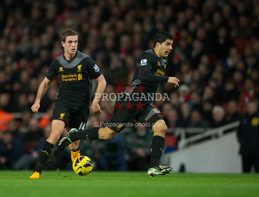 LONDON, ENGLAND - Wednesday, January 30, 2013: Liverpool's Jordan Henderson and Luis Alberto Suarez Diaz in action against Arsenal during the Premiership match at the Emirates Stadium. (Pic by David Rawcliffe/Propaganda)