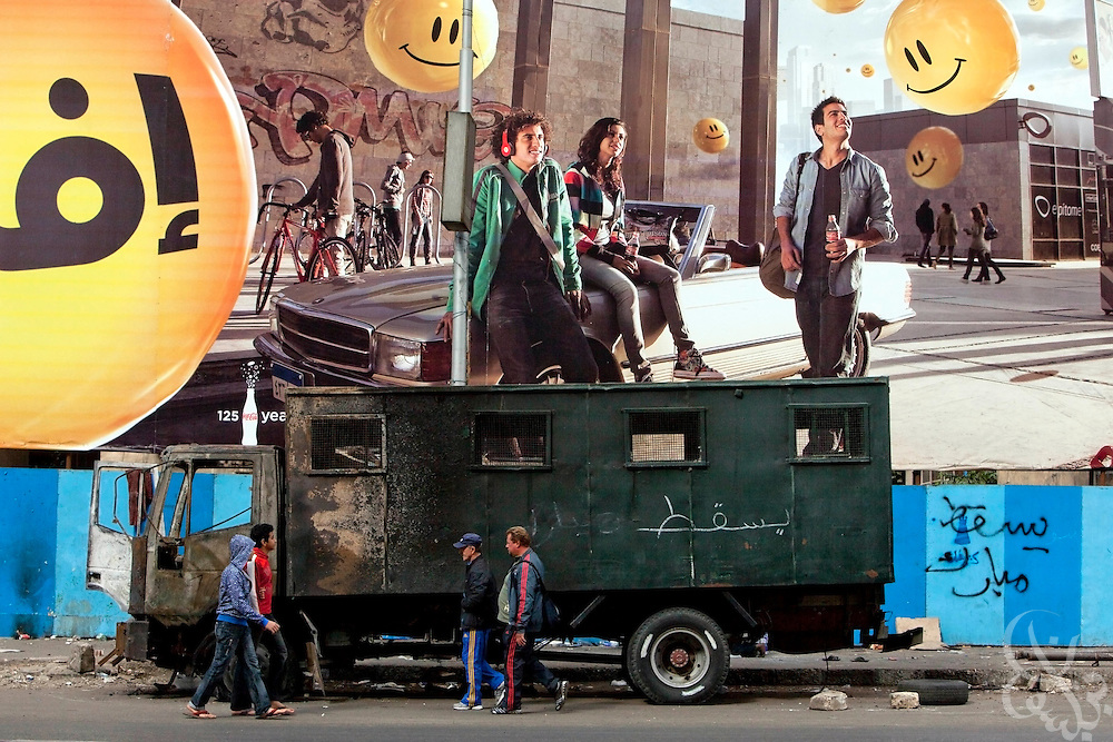 An Egyptian police truck remains burnt and battered in the Dokki district of Cairo, Egypt January 31, 2010. Egyptian police returned to the streets today for the first time since they lost control last Friday, and worked side by side with Egyptian Army soldiers who were brought in to stabilize the security situation.
